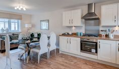 French interior designed Kitchen / Diner with oak flooring, oak worktops and sofa