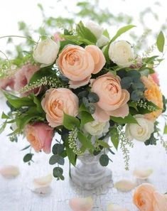 Flower Arrangement with peach and white roses Wedding Flower Arrangements, Floral Centerpieces, Wedding Centerpieces, Floral Arrangements, Wedding Bouquets, Wedding Flowers, Tall Centerpiece, Bridesmaid Bouquets, Purple Wedding