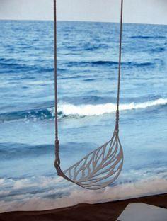 on a swing shaped like a leaf