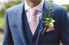 Grooms Navy suit and pink tie.
