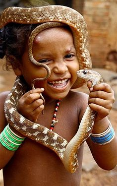 Image: A girl from a snake-charmer community on World Snake Day at Raigarh, India, on July 16 (© EPA)