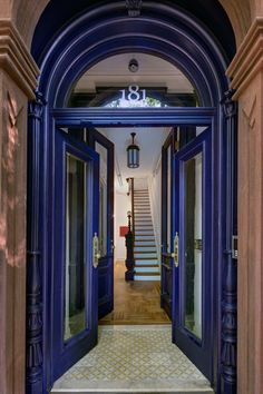 """It had already been butchered,"" architect Alexandra Barker, principal at Barker Freeman Design Office, said of the handsome, turn-of-the-century brownstone in Fort Greene's landmarked district that her team recently renovated. ""But the floors were okay, and we restored what we could."" The entry doors have been painted Benjamin Moore's Midnight Navy, and the new floor tiles are from Mosaic House."
