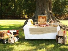 brown paper wrapped things and paper bags Fall-Harvest-Party-Ideas - white and brown table cloth...classy and simple.