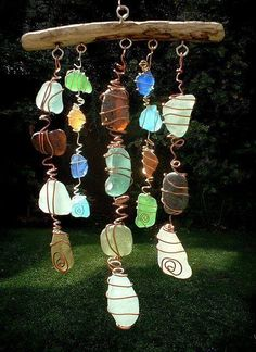 DIY Craft Projects-Twist WIRE around your favorite STONES and use hooks to attach to DRIFTWOOD.... Lovely to catch the suns rays!