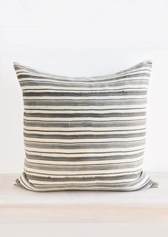 """Cut from rare vintagefabric that we sourcefromMali, Africaand reinventin our Brooklyn studio, this throw pillow flaunts the beauty of vintage textiles—showing off elevated texture and a special kind of magic that only comes with age. Limited edition run of 3. Size 24"""" x 24"""" Material Vintage cotton with natural lin"""