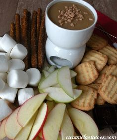 toffee fondue 6 Tbls. butter 1 cup brown sugar 2/3 cup corn syrup 1 (14 oz) sweetened condensed milk 1/2 cup toffee bits 1 tsp. vanilla  apples pears pretzel rods marshmallows chocolate bars