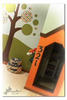 playhouse under the stairs - - see the whole playroom!  the tree is my favorite...