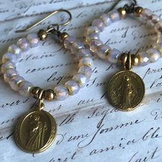 Vintage religious medals and Czech glass assemblage earrings ooak by Alpha Female Studio. https://www.etsy.com/listing/515831033/repurposed-vintage-gold-tone-religious