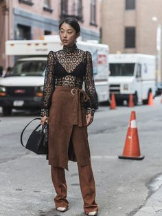 LOOK 1 wearing Zimmermann Margaret Zhang wearing Arcadia Knot Lace Blouse, Her the Label Bikini Top, Tibi Suede Wrap Skirt, Cmeo Collective Union Pant, Senso Roxi II Heels, BOYY Lucas Bag