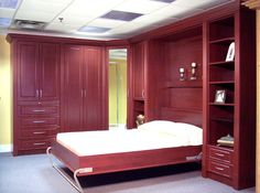 Wall bed with wardrobe units (open) Bed Shelves, Shelving, Bed With Wardrobe, Murphy Bed Ikea, Bed Wall, Custom Cabinetry, Two Bedroom, Ikea Ideas, Web Images