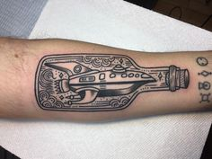 """""""Planet Express Ship in a Bottle"""" done by Allie Marie at Revolution Tattoo in Chicago IL."""