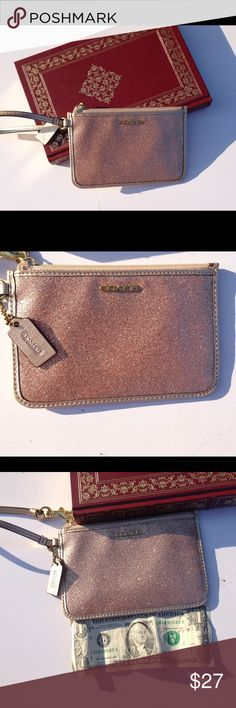 Coach Sparkly Gold Authentic Wristlet Coach wristlet gold in condition a few small stains on the inside. Offers welcome. No trades. Coach Bags Clutches & Wristlets