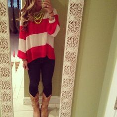 Red and white striped shirt, dark jeans, cowboy boots