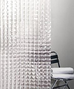 Cubic Clear Shower Curtain. I like the clean modern look of this shower curtain. Also, it filters in light beautifully and keeps the bathroom looking spacious.