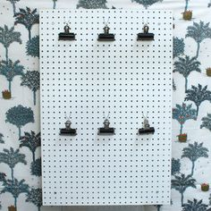 I like the use of the metal clips to hang things on peg board hooks.