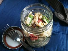 Picnic in a Jar - Orzo, asparagus, tomatoes, sun-dried tomatoes, artichoke hearts, feta, and lemony dressing! Delicious vegetarian lunch or dinner. Great spring or summer recipe!