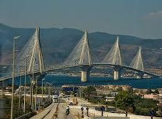 The Rio-Antirio bridge is located to the north of Patras and links the Peloponnese peninsula to mainland Greece, and was completed in August 2004 Greece Tours, Greece Travel, Time Travel, Places To Travel, Cable Stayed Bridge, City By The Sea, Greek Beauty, Bridge Design, Greece Islands