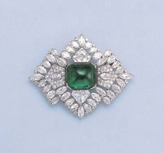 A FINE ART DECO EMERALD AND DIAMOND BROOCH, BY BOUCHERON  Of openwork design, the central cabochon emerald within stylized geometric diamond surround to the alternating marquise and single-cut diamond border, circa 1935, 7.0 cm. long, in grey suede fitted case by Boucheron Signed Boucheron Paris