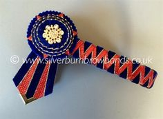 Navy edge gold velvet and red lame sharkstooth show browband shown with angled pointed flags  www.silverburnbrowbands.co.uk