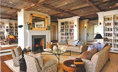 Wow! Check out the reclaimed wood ceiling and all the built ins in this cozy family room; amazing work!