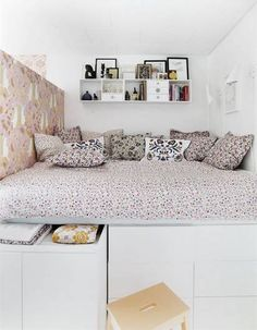 decorating small spaces floral bedding with white drawers underneath