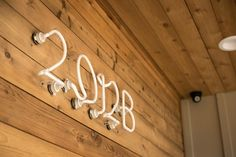 These neon house numbers look super cool at night. Get more DIY house number ideas here >> http://blog.diynetwork.com/maderemade/2015/08/17/diy-house-numbers/?soc=pinterest