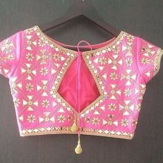 Check out the latest saree blouse designs for back and front for festive seasons like Durga puja, karwa chauth and Diwali. Also, see the latest choli designs and blouses for Navratri dandiya and Garba dance. Blouse Back Neck Designs, Fancy Blouse Designs, Latest Blouse Designs, Mirror Work Saree Blouse, Mirror Work Blouse Design, Boat Neck Saree Blouse, Lehenga Blouse, Stylish Blouse Design, Designer Blouse Patterns