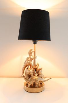Take a look at this beautifully crafted dinosaur lamp! All your favorite dinosaurs are painted gold and assembled cleverly on this very unique lamp. This would be perfect as an accent lamp or table la Dinosaur Room Decor, Dinosaur Bedroom, Boy Room, Kids Room, Ideias Diy, Unique Lamps, Handmade Home, Diy Furniture, Diy Home Decor