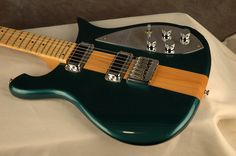 """a beauty. Rickenbacker's """"cresting wave"""" body on the 650 Atlantis, with a maple and deep turquoise finish topped with chrome pick guard and knobs. i would trade my right hand for a lefty model---oh wait..."""