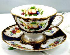 "Elegant Teacup & Saucer, Fruit, Floral Pattern, Gold trimmed, Fine Bone English China made by ""Duchesss"" , England."