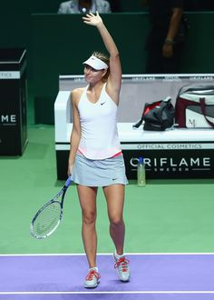 Maria Sharapova Photos: BNP Paribas WTA Finals: Day 5. Maria Sharapova of Russia waves to the crowd after her three set victory against Agnieszka Radwanska of Poland in their round robin match during the BNP Paribas WTA Finals at Singapore Sports Hub on October 24, 2014 in Singapore.