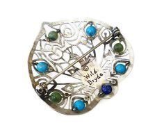 Vintage Wild Bryde peacock motif silver tone rhodium plated glass bead brooch. Age: circa approximately 1980s to early 90s. Hallmarks: it is marked Wild Bryde on the back. Measurements: it is 1-5/8 tall x 1-3/4 wide. Condition: it is in overall good condition. There is no damage, only light wear consistent with age.  ********************************************************* We offer free shipping within the United States! International shipping rates are as listed.  Enter my shop here for…