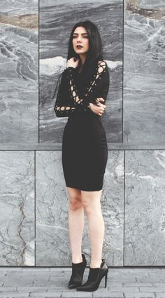 Laced up sleeves bodycon dress with black heeled ankle boots - http://ninjacosmico.com/11-ways-wear-black-dresses-summer/