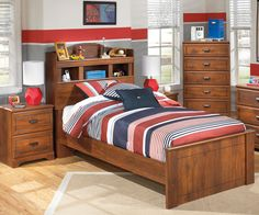 """Ashley Furniture, """"Barchan"""" ; The rich rustic look of the finely crafted """"Barchan"""" youth bedroom collection features a warm brown replicated Timber Cherry grain that beautifully accents the half round bead frame detailing and the vintage aged copper color finished hardware to create a bedroom your child will enjoy spending time in."""