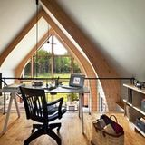 Tucked away within attics, or at the top of high ceilings, lofted offices provide just enough privacy while still being connected to the rest of the home. From the tiniest desks nestled in at the top of a landing to expansive studies open to living rooms below, these office lofts make work look fun.