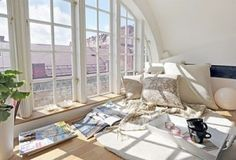I love this! I would put giant pillows everywhere and have sun catchers all over the windows.