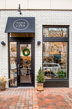 The Most Beautiful Independent Store in Every State in America The faade of Kansas jewel Hand Land is coated a white brick that calls to the white tile interiors. Building Front, Building Exterior, Brick Building, White Building, Small Coffee Shop, Coffee Shop Design, Cute Coffee Shop, Coffee Store, Small Store Design
