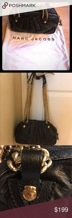 Marc Jacobs black gold chain leather hand bag Used beautiful Marc Jacobs black leather hand bag with gold chain. Quotes design on sides. Comes with Marc Jacobs dust bag. Marc Jacobs Bags Shoulder Bags