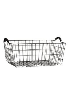 Large wire basket: Rectangular metal wire basket with two handles at the top. Size 16.5x28x40 cm.