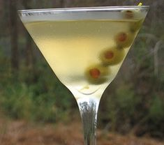 The Perfect Dirty Martini  3 oz. Gin  .25 oz Dry Vermouth  .25 oz Juice from the Olive Jar  Green Olives to garnish