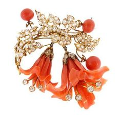 19th century brooch of carved coral lilies nestled among 18K yellow gold chrysanthemum leaves set with old mine cut diamonds, France, ca. 1870