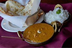 Everest Curry Kitchen in Sandy offers a tender and succulent lamb korma alongside an order of butter naan. (Francisco Kjolseth | The Salt Lake Tribune)