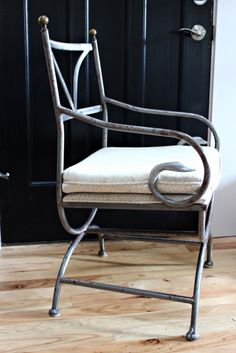 I love this chair - the swans on the arm pieces, the graceful sturdiness of it. I'm so jealous this blogger found it, lol.