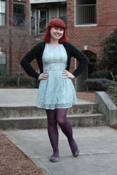Blue Lace Fit and Flare Dress, Cropped Black Cardigan, Purple Tights, and Colorful Snake Skin Flats