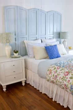 Practically anything can be upcycled into a headboard, including old shutters. We particularly love the clean arches these powder blue ones create. Get the tutorial at The Lettered Cottage.   - CountryLiving.com