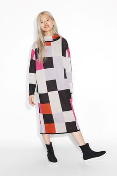 Be the colour in a wintry landscape with this thoroughly fabulous long sleeve knit dress. Colour-blocking at its best.