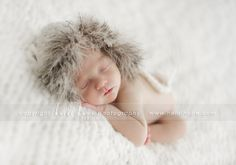 Newborn baby A, a teeny social butterfly, visits the studio for her newborn portraits.