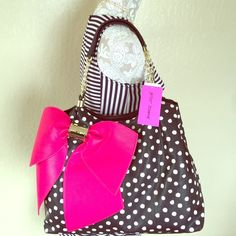 Betsy Johnson Pink BOW-LICIOUS Spot Large Tote Betsy Johnson Pink BOW-LICIOUS Black and White Spot Large Tote. Brand New with Tags. Gold Tone Findings. Zipper pouch inside along with middle zipper closing section. Cell phone pockets. Fun pink lips and roses lining. 22 inches tall including shoulder straps. 16.5 inches long. No trades. Betsey Johnson Bags