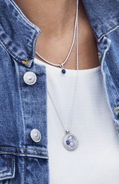 Add a fresh twist to your autumn outfits with beautiful synthetic sapphire necklaces celebrating September birthdays. Style tip: layer short and long necklaces to take your look to the next level.
