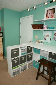 love the idea of the shelf to divide a room.  would work in more than just a craft room if the space was right